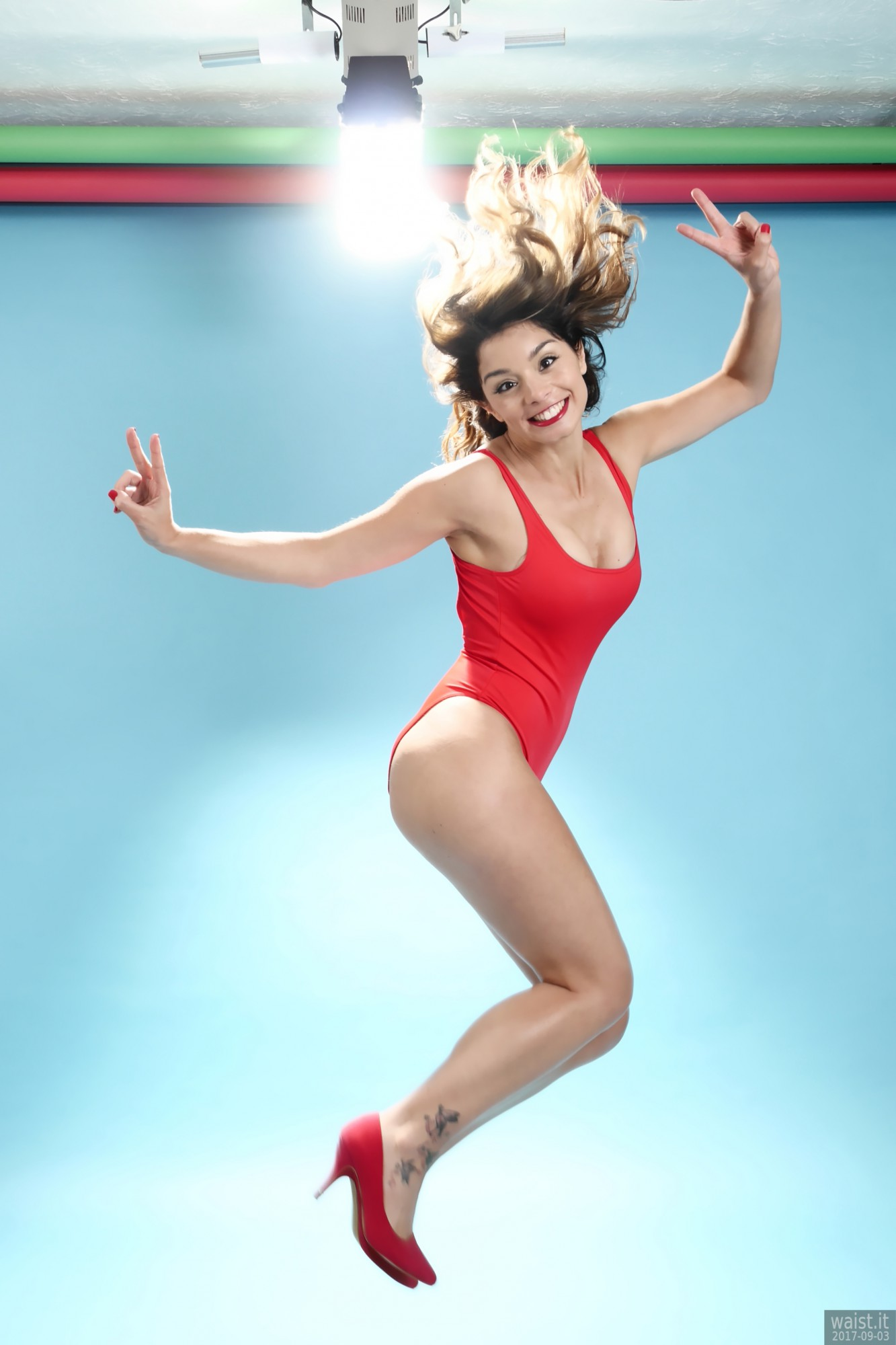 2017-09-03 Kris in red baywatch one-piece swimsuit, jumping for joy