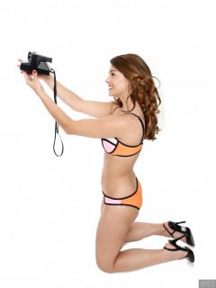 2017-09-03 Paula Soares in multicoloured neoprene bikini with Polaroid Land Camera