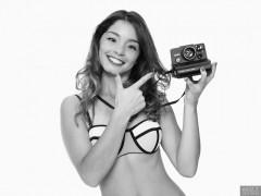 2017-09-03 Kris in multicoloured neoprene bikini with Polaroid Land Camera