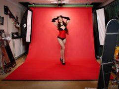 Studio wide-angle shot - Charlene Joy in tightly-laced red underbust corset, worn over tight black Miraclesuit bodyshaper