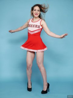 2018-04-07 Annie91 in her cheerleader costume, worn over red one-piece swimsuit