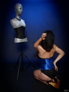 2018-06-15 Tatjana Bastet in tight-laced blue corset worn over black Miraclesuit bodyshaper