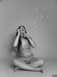 2018-06-15 Tatjana Bastet blowing bubbles in red and white polka-dot bikini