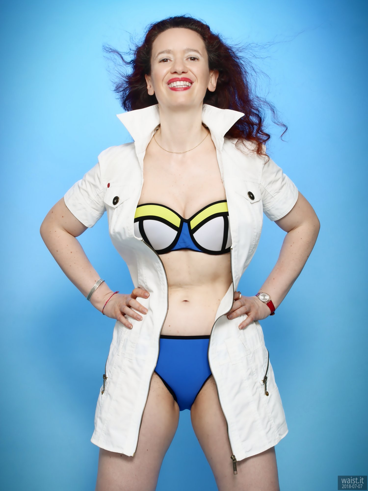 2018-07-07 Chiara in her own white canvas minidress, worn over blue-multi-coloured neoprene bikini