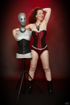 2018-07-07 Chiara in her own tightly-laced, long-line burgundy over-bust corset, worn over firm-control burgundy pantie-girdle, worn as hotpants