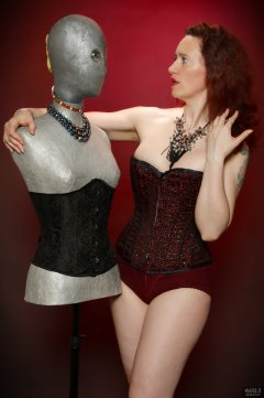 2018-07-07 Chiara in tightly-laced, in her burgundy Vollers over-bust corset, worn over firm-control burgundy pantie-girdle, worn as hotpants