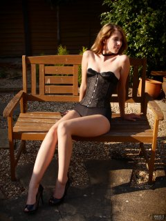 2018-07-25 Twinklenose, in the garden, in tightly-laced black underbust corset worn over black bra and black pantie girdle, worn as hotpants