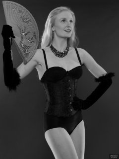 2018-09-01 Christina Elsom - in plack bra and black high-waisted control briefs worn as hotpants, and ticghtly-laced black underbust corset