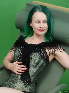 2018-09-16 Saffine in her own tightly-laced, green brocade, overbust corset and style 210 pantie girdle, worn as hotpants