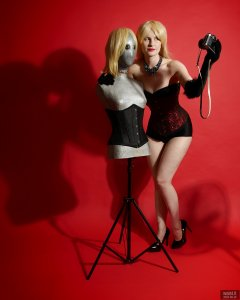 2018-09-16 Saffine poses with silver droid and Pentax ME Super camera, in her own red and black tightly-laced overbust corset and style 210 pantie girdle worn as hotpants
