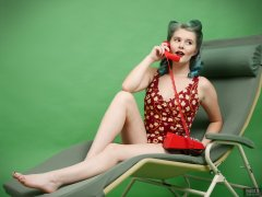 2018-11-04 Sophie Pixie poses on Relaxator 365 lounger chair, using red Trimphone, wearing red and gold vintage tummy-control one-piece swimsuit