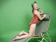 2018-11-04 Sophie Pixie poses on Relaxator 365 lounger chair, wearing red and gold vintage tummy-control one-piece swimsuit
