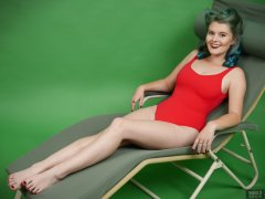 "2018-11-04 Sophie Pixie poses on Relaxator 365 lounger chair, wearing red ""baywatch"" style one-piece swimsuit"