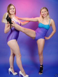 2019-05-04 CloEliza and Fabiene working out in purple vintage tummy-control one-piece swimsuits