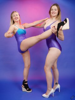 2019-05-04 Fabiene and CloEliza working out in purple vintage tummy-control one-piece swimsuits