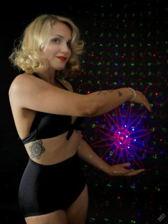 "2019-09-07 VZ-Retro - in black bra top and black ""style 210"" pantie girdle, worn as hotpants - lit by LED, with laser-gobo background"