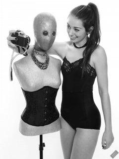 "2020-02-02 Jessica Maria with illuminated ""alien"" mannequin. Jessica wears  black strapless bra and high-waist control-briefs, worn as hotpants"