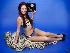 2020-02-02 Jessica Maria listens to vintage Radio Exchange Roamer Ten reciever. Jessica wears blue neoprene bikini