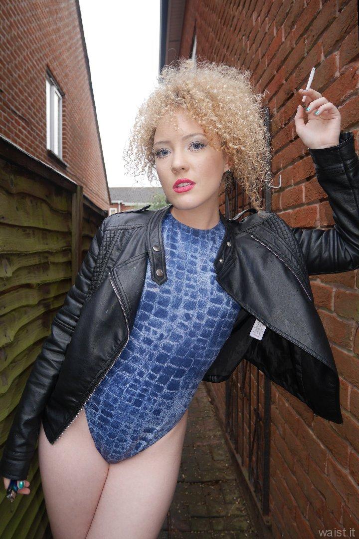 2015-08-14 2015-08-14 Jazz in blue M&S croc skin swimsuit.leaning on brick wall in passageway blue M&S croc skin swimsuit