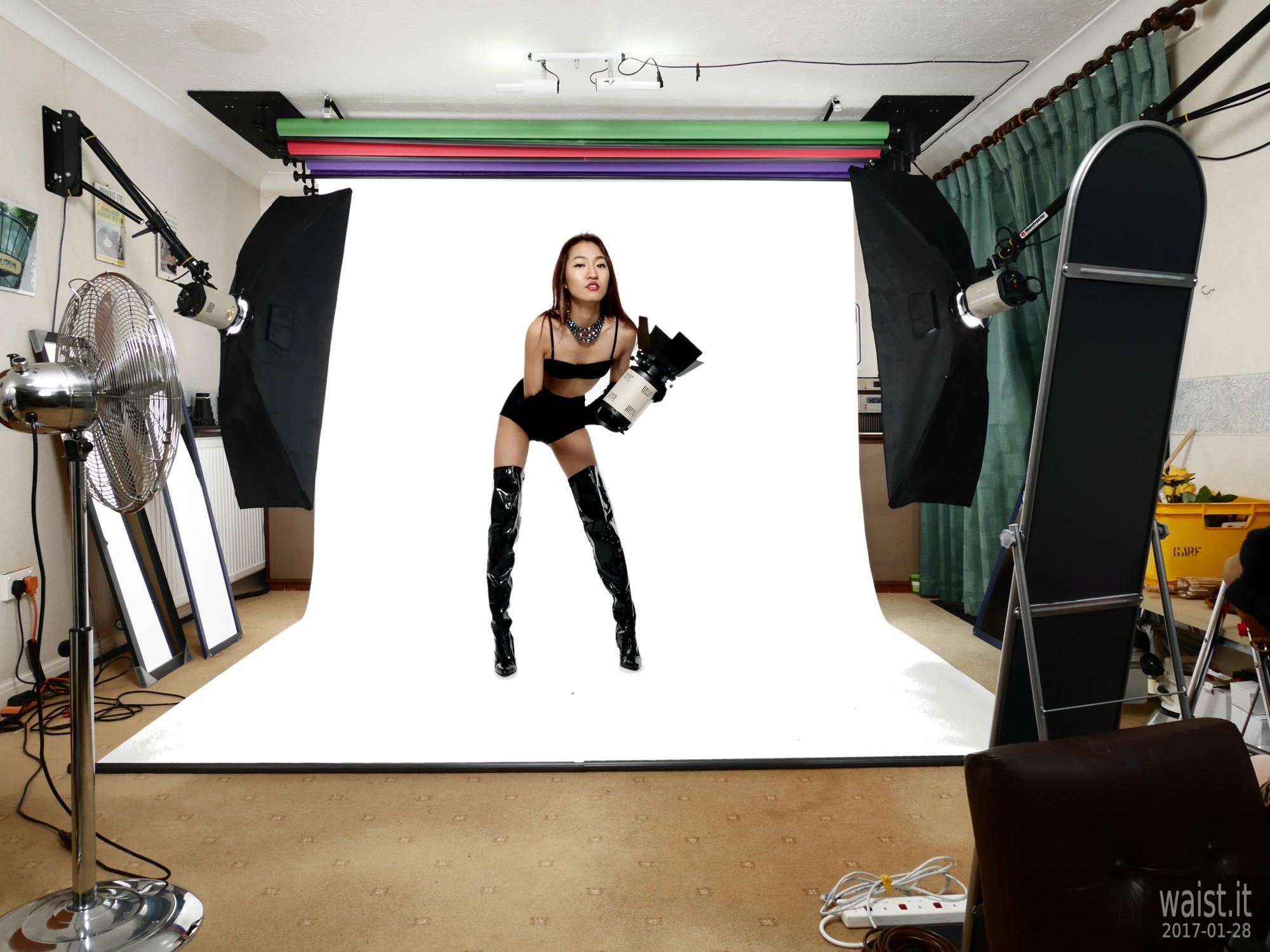 2017-01-28 Salina Pun black bra, girdle, opera gloves and patent leather thigh boots, studio long shot