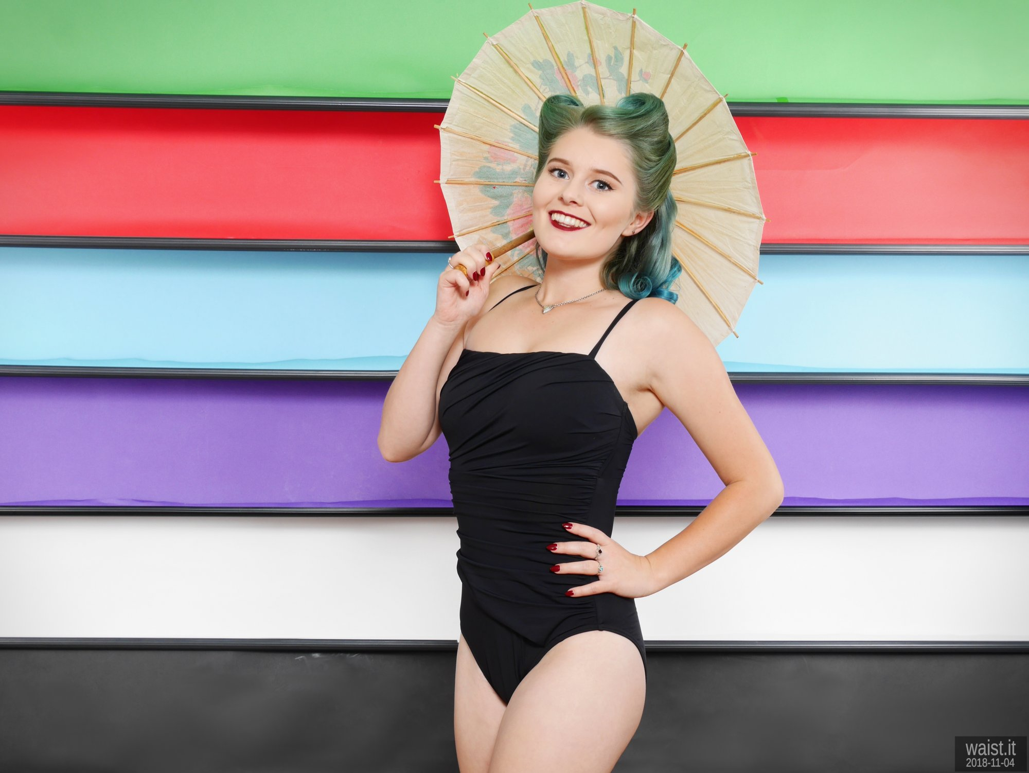 2018-11-04 Sophie Pixie in black vintage-style tummy-control swimsuit, demonstrating the studio
