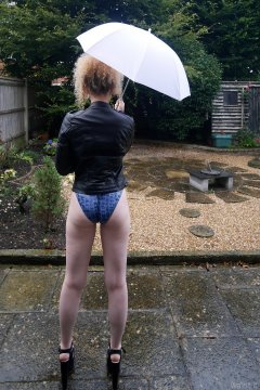 2015-08-14 Jazz in blue M&S croc skin swimsuit, in the garden, in the rain