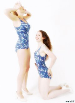 Nikki & Chiara working out in blue patterned 50's style swimsuits