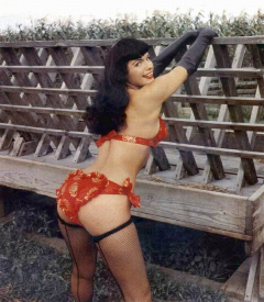 Bettie Page posing in red and gold swimsuit