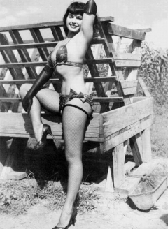 Bettie Page posing in swimsuit