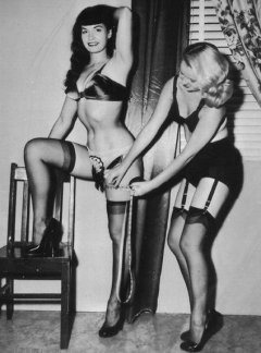 Bettie Page beaing measured by a freind