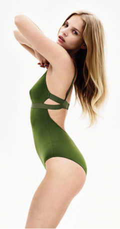 Unknown model wearing green one-piece swimsuit